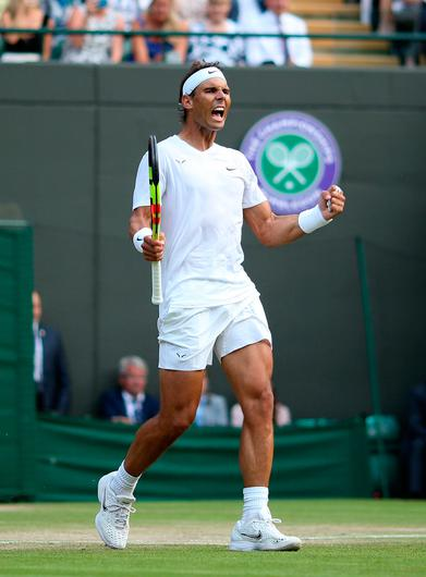 Rafael Nadal celebrates victory after his match against Sam Querrey on day nine of the Wimbledon Championships