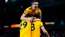 Wolverhampton Wanderers' Ruben Neves celebrates scoring his side's second goal of the game with Ruben Vinagre and Conor Coady (top) during the Emirates FA Cup, third round match at Molineux, Wolverhampton. Monday January 7, 2019.  Nick Potts/PA