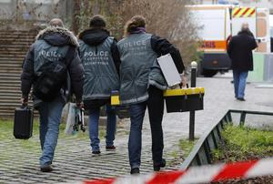 Police investigators are seen at the scene after a shooting at the Paris offices of Charlie Hebdo, a satirical newspaper, January 7, 2015.  REUTERS/Jacky Naegelen