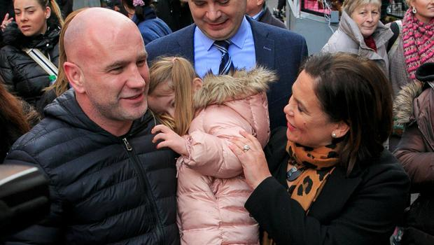 Canvass: Sinn Féin leader Mary Lou McDonald chats with Kenneth Keenan and Grace Byrne Keenan (4) from Artane on Moore Street, Dublin. Photo: Gareth Chaney, Collins
