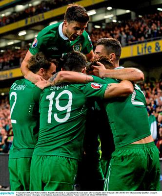 7 September 2015; Jon Walters, hidden, Republic of Ireland, is congratulated by team-mates after scoring his side's first goal. UEFA EURO 2016 Championship Qualifier, Group D, Republic of Ireland v Georgia, Aviva Stadium, Lansdowne Road, Dublin. Picture credit: Cody Glenn / SPORTSFILE