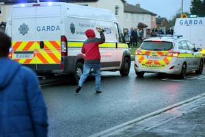 A rioter throws a brick at a garda car during a Anti Water charges demonstration in Jobstown. Photo: Tony Gavin