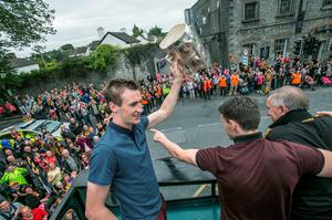 7/9/2015: Kilkenny captain Joey Holden lifts the Liam McCarthy Cup aloft as the team bus leaves Kilkenny castle Park on the way to Nowlan park during the homecoming for the Kilkenny team. Photo: Pat Moore.