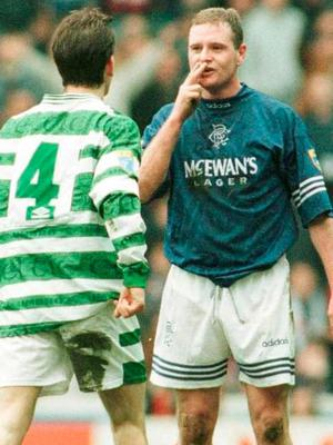 Paul Gascoigne gestures to Celtic's Jackie McNamara back when Rangers could still attract star names and the rivalry was red hot. Photo: Clive Mason/Allsport