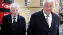 Former governors of Bank of Ireland Laurence Crowley (left) and Richard Burrows arriving for the Oireachtas Banking Inquiry at Leinster House yesterday.