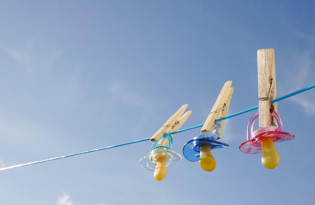 Pacifiers on clothes line