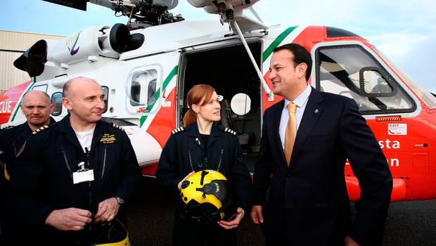 Minister for Transport Tourism and Sport, Leo Varadkar pictured with the crew of the new Coast Guard Sikorsky S92 helicopter for the East Coast region at the launch of the new helicopter at Weston Airport this morning..The crew are from left, Winchman Dermot Molloy Capt. Ed Sullivan, and Capt. Dara Fitzpatrick ....Picture Colin Keegan, Collins Dublin.