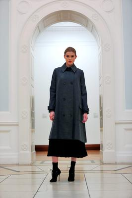 Eve Connolly wears a grey double breasted flared coat at EUR425 with pleated crepe dress at EUR295 pictured at the Hugh Lane Gallery