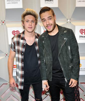 Recording artists Niall Horan (L) and Liam Payne of the music group One Direction attend the 2014 iHeartRadio Music Festival at the MGM Grand Garden Arena