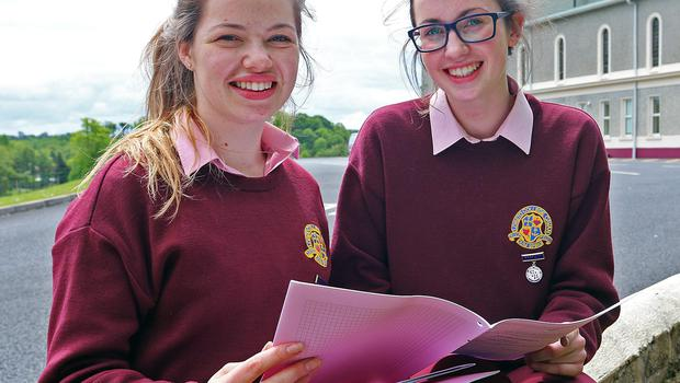 Frida Ni Dholain and Dearbhla Dolan of Loreto College, Cavan, look over their Maths papers yesterday afternoon