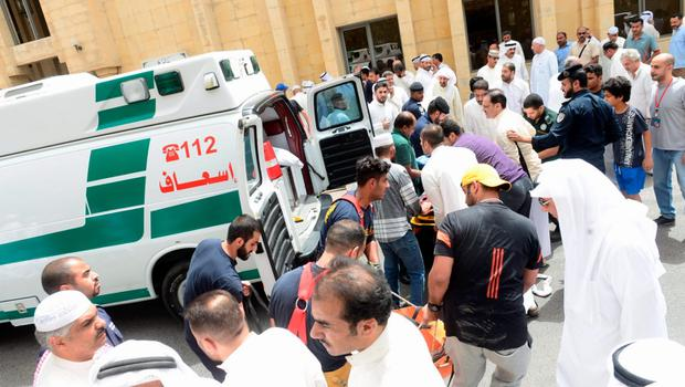 People help carry injured victims to ambulances outside Imam al-Sadeq Mosque, after a suicide bomb attack, in Kuwait city June 26, 2015. A suicide bomber killed 25 people when he blew himself up inside a packed Shi'ite Muslim mosque in Kuwait city during Friday prayers, the interior ministry said, the first attack of its kind in the major oil-exporting country. The Islamic State militant group claimed responsibility for the attack, which also wounded 202 people according to the interior ministry, in the district of Sawaber in the eastern part of the Kuwaiti capital. REUTERS/Stringer