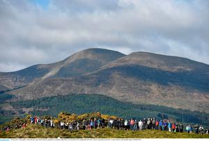 28 May 2015; A large gallery watches the day's play with the Mourne mountains as a backdrop. Dubai Duty Free Irish Open Golf Championship 2015, Day 1. Royal County Down Golf Club, Co. Down. Picture credit: Brendan Moran / SPORTSFILE