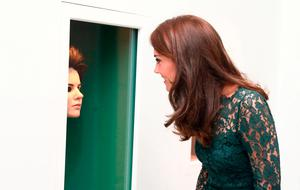 Britain's Catherine, Duchess of Cambridge views work by artist Gillian Wearing during the 2017 Portrait Gala, at the National Portrait Gallery in London on March 28, 2017