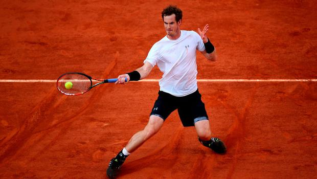 Determination is the name of the game as Andy Murray returns a shot against Novak Djokovic at Roland Garros. Photo: Dan Istitene/Getty Images