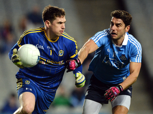 Darren O'Malley of Roscommon in action against Bernard Brogan of Dublin during the match at Croke Park. Photo: Daire Brennan/Sportsfile