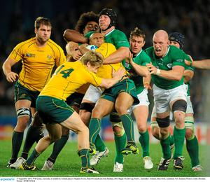 17 September 2011; Will Genia, Australia, is tackled by Ireland players Stephen Ferris, Paul O'Connell and Eoin Reddan. 2011 Rugby World Cup, Pool C, Australia v Ireland, Eden Park, Auckland, New Zealand. Picture credit: Brendan Moran / SPORTSFILE