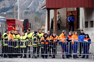 French firefighters and rescue members gather outside the gymnasium where relatives and officials are due to pay tribute to the victims of the Airbus A320 crash, in Seyne-les-Alpes, March 25, 2015. REUTERS/Eric Gaillard