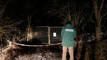 A policeman stands in front of an entrance leading to the site where six teenagers were found dead after holding a party in a garden near Arnstein, southern Germany, on January 29, 2017. (Photo: Getty Images)