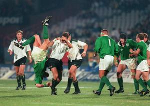 Victor Costello is tackled in the air during the 'Battle of Pretoria' between Ireland and South Africa in 1998. © INPHO/Billy Stickland