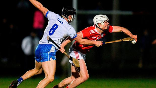David Griffin of Cork is tackled by Jamie Barron of Waterford. Photo: Eóin Noonan/Sportsfile