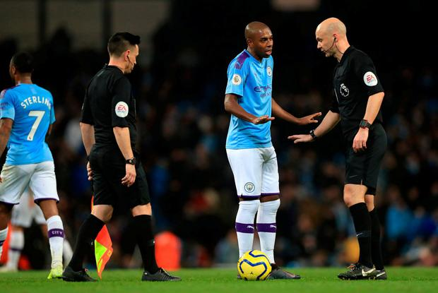 OUT OF POSITION: Manchester City's Fernandinho appeals to match referee Anthony Taylor during the Manchester derby at the Etihad Stadium. Photo: PA