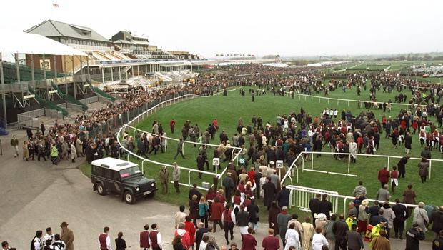 Crowds file on to the Aintree course due to the IRA bomb scare which postponed The Grand National to April 7th at the Aintree Racecourse, Liverpool, England.. \ Mandatory Credit: Mike Cooper /Allsport