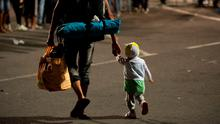 Migrants arrive at the border between Austria and Hungary near Heiligenkreuz, about 180 kms (110 miles) south of Vienna, Austria, Saturday, September 19, 2015. (AP Photo/Christian Bruna)