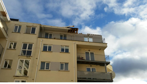 Storm Frank damaged the roof of an apartment block in Clondalkin Credit: Twitter/Dublin Fire Brigade