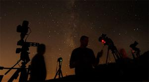Los Angeles photographers Shawn Kaye, Scott Meadows and Steve Gentry set their cameras pointed to the stars during the Perseid meteor shower early on Monday morning north of Castaic Lake, California
