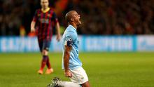 Manchester City's Vincent Kompany reacts after a decision goes against him during the UEFA Champions League, Round of 16 match at the Etihad Stadium.