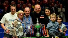 Stuart Bingham celebrates with his family and the trophy after winning the Betfred World Championships at the Crucible Theatre, Sheffield. PRESS ASSOCIATION Photo. Picture date: Monday May 4, 2015. See PA story SNOOKER World. Photo credit should read: Anna Gowthorpe/PA Wire