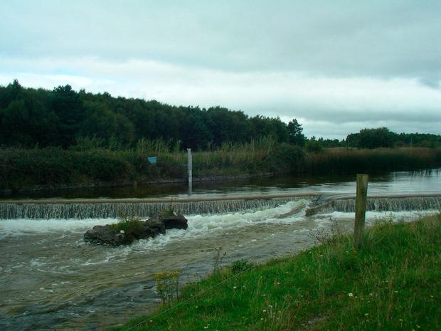 Two photos of Keel Weir in Achill Island, Co Mayo, showing the normal water level (pictured) and the low level in the current drought. The fish pass for salmon is completely dry.