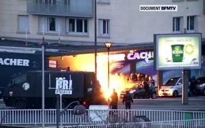A still image form video shows an explosion lighting the front of a kosher supermarket as French police special forces launch their assault, where several people were taken hostage near the Porte de Vincennes in eastern Paris January 9, 2015. Two brothers suspected of a bloody attack on the offices of French satirical newspaper Charlie Hebdo were killed when police stormed their hideout northeast of Paris on Friday, while a second siege at the supermarket ended with the deaths of four hostages