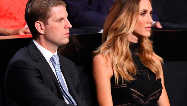 Donald Trump's son Eric Trump and his wife Lara Yunaska attend the final night at the Republican National Convention at the Quicken Loans Arena in Cleveland, Ohio on July 21, 2016. / AFP / Robyn BECK        (Photo credit should read ROBYN BECK/AFP/Getty Images)
