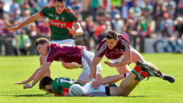 14 June 2015; Kevin McLoughlin and Diarmuid O'Connor, Mayo, in action against Thomas Flynn and Sean Denvir, Galway. Connacht GAA Football Senior Championship Semi-Final, Galway v Mayo. Pearse Stadium, Galway. Picture credit: David Maher / SPORTSFILE