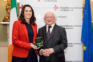 Honoured: President Michael D Higgins and Irish Red Cross nurse Vivien Lusted. Photo: Conor Healy  / Picture It Photography