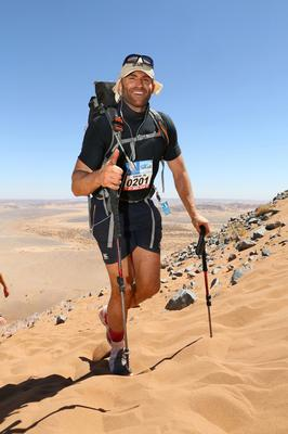 Damian Browne manages a smile during the 2016 Marathon des Sables (MdS), a six-day, 295km ultramarathon staged annually in the Sahara Desert. Photo: A360DEGRES/Damian Browne
