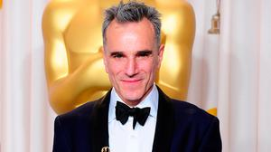 Method to the madness: Daniel Day Lewis with one of his three Oscars