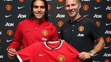 New signing Radamel Falcao with assistant manager Ryan Giggs