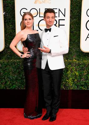 Actors Amy Adams and Jeremy Renner attend the 74th Annual Golden Globe Awards at The Beverly Hilton Hotel on January 8, 2017 in Beverly Hills, California.  (Photo by Frazer Harrison/Getty Images)