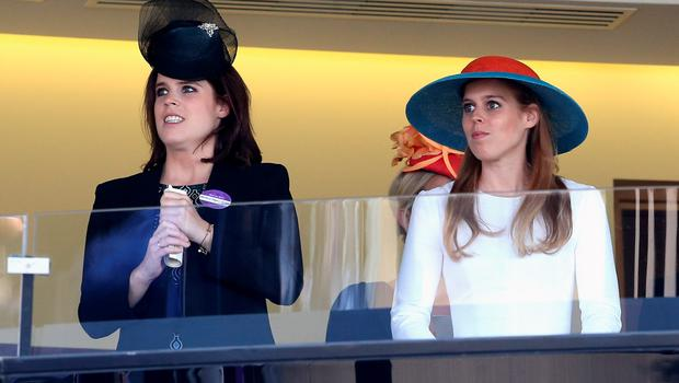 ASCOT, ENGLAND - JUNE 18:  Princess Eugenie and Princess Beatrice in watch the Queen's horse in the final race as they attend Ladies Day on day 3 of Royal Ascot at Ascot Racecourse on June 18, 2015 in Ascot, England.  (Photo by Chris Jackson/Getty Images)