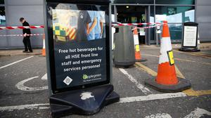 A sign reading 'Free hot beverages for all HSE front line staff and emergency services personnel' is seen at a service station in Castlebellingham as the spread of the coronavirus disease (COVID-19) continues in Ireland. Photo: REUTERS/Jason Cairnduff