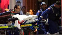A blood soaked stretcher is wheeled to an ambulance after shots were fired during  a cafe  siege at Martin Place in the central business district of Sydney, Australia, Tuesday, Dec. 16, 2014