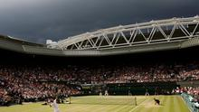 Dark clouds drift over centre court during the finals match between Roger Federer of Switzerland and Rafael Nadal of Spain at Wimbledon