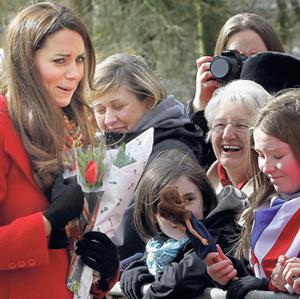 Above and below left: Kate Middleton is shown a lookalike doll by Dayna Miller (11) on her visit to Dumfries House in Ayrshire, Scotland