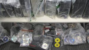 Items seized as part of a joint operation against those accessing indecent images of children online (PSNI/PA Wire)