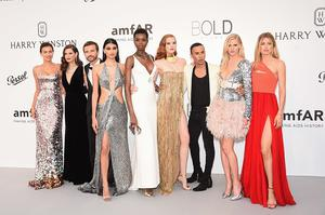 (L-R) Irina Shayk, Bianca Balti, Pierre Emmanuel Angeloglou, Neelam Gill, Maria Borges, Alexina Graham, Olivier Rousteing, Lara Stone and Doutzen Kroes arrives at the amfAR Gala Cannes 2017 at Hotel du Cap-Eden-Roc on May 25, 2017 in Cap d'Antibes, France.  (Photo by Stephane Cardinale - Corbis/Corbis via Getty Images)