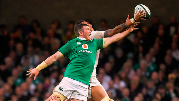 Peter O'Mahony puts Courtney Lawes under pressure from an England lineout. Photo: Brendan Moran/Sportsfile