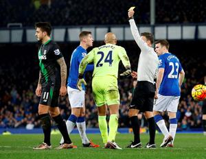 Everton's John Stones is shown a yellow card after conceding a penalty. Photo: Carl Recine / Action Images via Reuters
