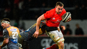 Munster's Tommy O'Donnell is tackled by Scarlets' Steffan Hughes. Photo: Sportsfile